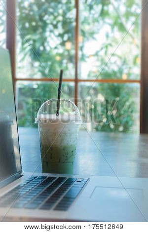 Laptop On Wooden Table At Coffee Shop stock photo