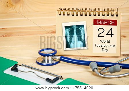 World Tuberculosis Day and x ray of pulmonary lung disease lung with stethoscope medical and document file.