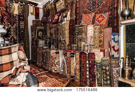 Old carpet shop in eastern city. Souvenirs shop
