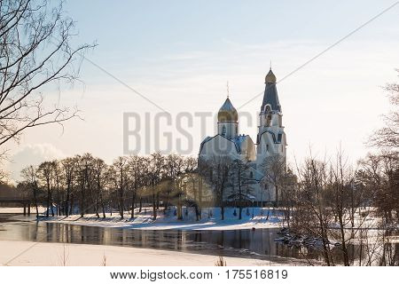 View to Russian Orthodox Church on the shore of frozen river , Saint-Petersburg region, Russia in the beginning of Spring. The Church on the River .Orthodox church and a symbol of medieval Russia.