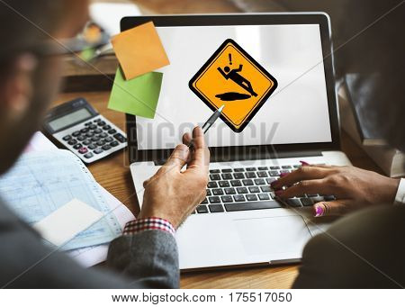 Business People Discussion Slip Caution Sign Attention on Laptop