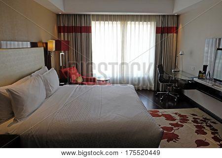 AGRA, INDIA - FEBRUARY 14: Modern hotel bedroom interior in Four Points by Sheraton Agra, Uttar Pradesh, India on February 14, 2016.