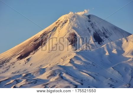 Aerial image of snow-covered Russian Volcano. Kamchatka.