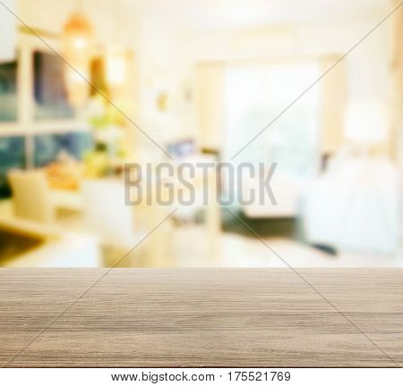 Wooden Table Top With Blur Of Dining Table In Modern Dining Room Interior