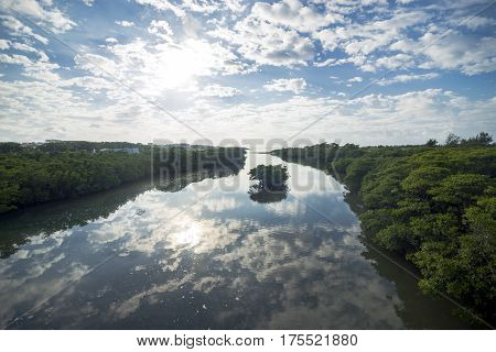 Morning Miyara river with sky reflection between mangrove in Ishigaki island