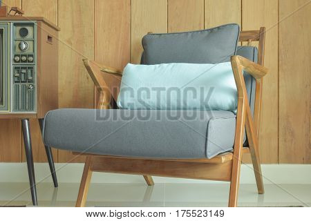 Easy Lounge Chair With Wooden Wall  Background In Retro Style Decoration