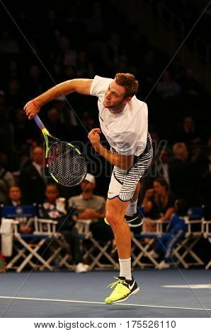 NEW YORK - MARCH 6, 2017: Professional tennis player Jack Sock of United States in action during  BNP Paribas Showdown 10th Anniversary tennis event at Madison Square Garden in New York