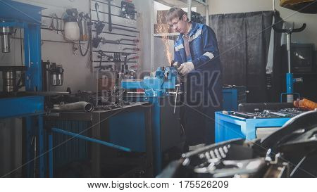 Car auto workshop - grinding metal construction in - sparks of circular saw, horizontal