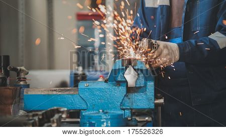 Sparks of circular saw - grinding metal construction in car auto workshop, horizontal