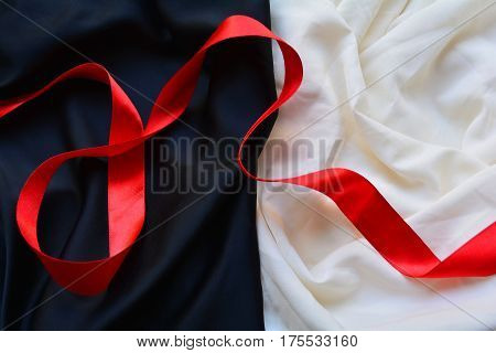red silk ribbon on a black and white background