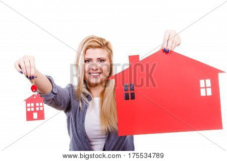 Ownership property real estate concept. Blonde woman holding red paper house symbol and key. New flat apartment. Isolated on white
