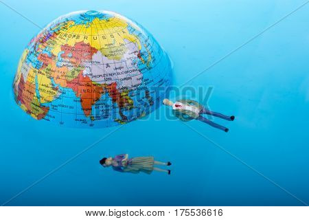 Little Globe With    Floating Figurines Around