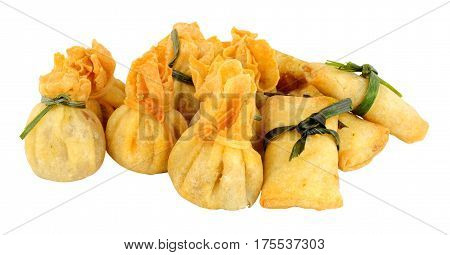 Group of mixed Oriental pastry wrapped snacks isolated on a white background