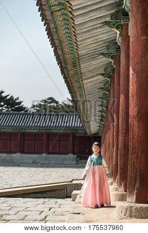 Beautiful Korean Girl In Hanbok At Gyeongbokgung, The Traditional Korean Dress.