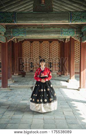 Beautiful Korean girl in Hanbok at Gyeongbokgung the traditional Korean dress.