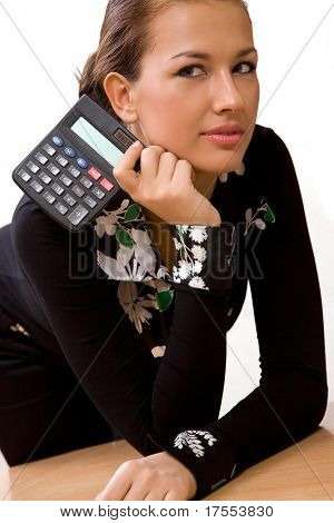 Beautiful young woman holding a calculator