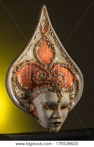 Beuaty Venetian mask isolated on black and yellow background