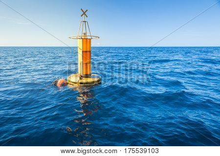 Yellow Sea Buoy in blue Sea at Andaman Sea, Thailand