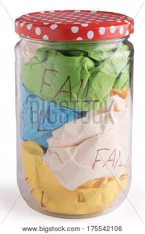 crumbled color paper in closed glass jar bottle