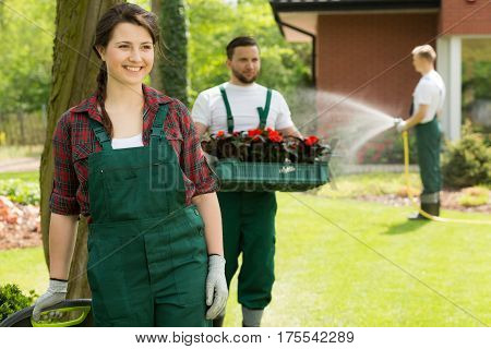Cheerful Gardener Enjoying Work In Garden