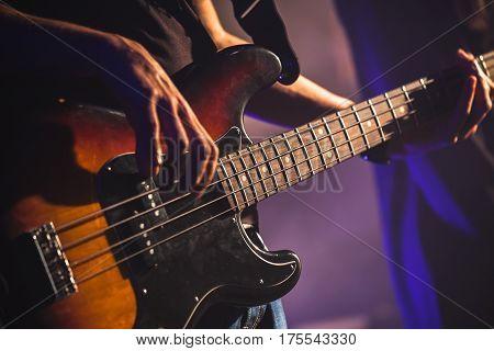 Close-up Photo Of Bass Guitar Player