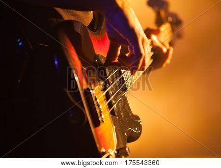 Closeup Photo Of Bass Guitar Player