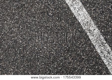 White Dividing Line On Dark Gray Tarmac
