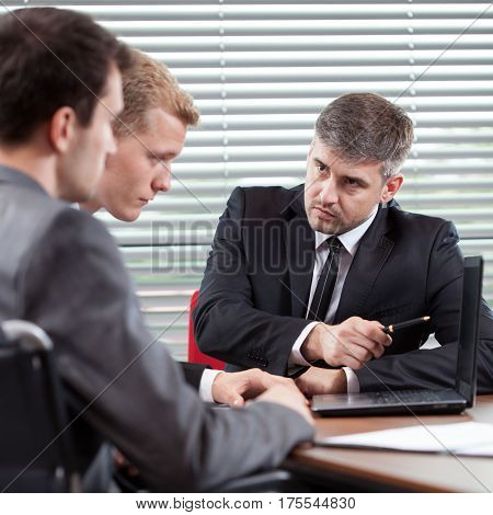 Disabled Man And His Co-worker Talking With Boss