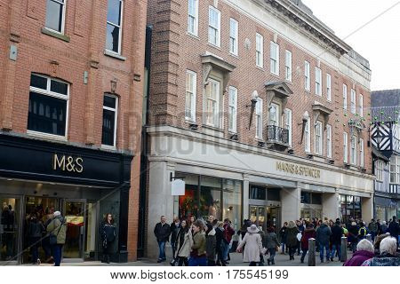 CHESTER, UK - NOVEMBER 19, 2016: Members of the public can be seen outside the Marks and Spencer shop on Foregate street, Chester city centre, Chester, Cheshire, UK
