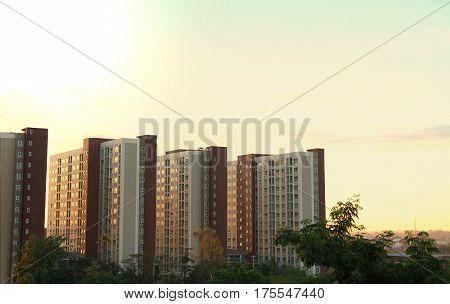 Condominium or apartment building during sunrise in the morning.