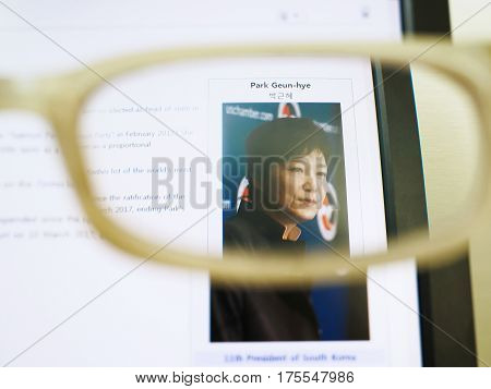 SEOUL SOUTH KOREA - March 10 2017: Photo of Wikipedia web page about Park Geun-hye on a monitor screen through glasses.