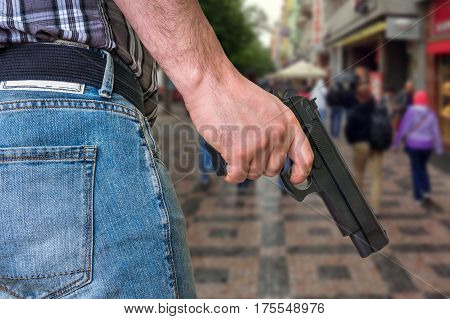Killer With Pistol And Crowd Of People On The Street