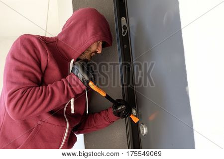 Burglar Trying To Force A Door Lock