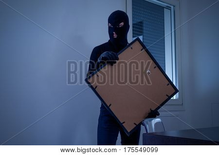 Thief Inside Home  Stealing A Painting