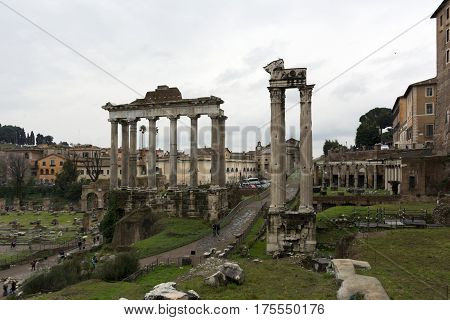 antique stone marble ruins of the Roman forum Rome Italy spring cloudy after rain the verdure of the grass
