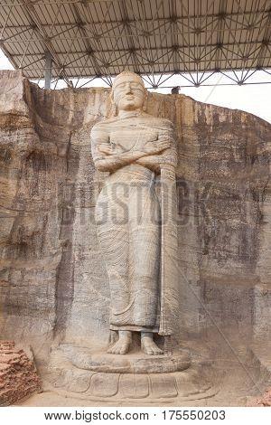 Statue of standing Buddha at Gal Vihara in Polonnaruwa or Pulattipura ancient city Kingdom of Polonnaruwa in Sri Lanka