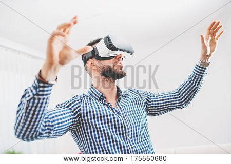 Handsome, Bearded Man Wearing Virtual Reality Goggles In Modern Interior Design Coworking Studio. Sm