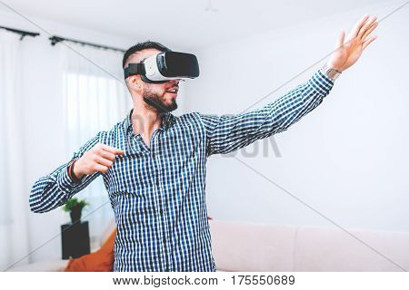 Young Man Experiencing Games With Virtual Reality Goggles. Headset Vr Device Playing With Smartphone