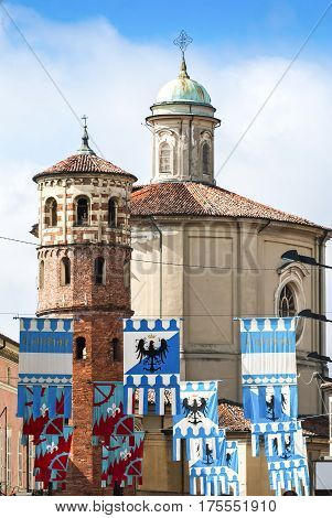 Colorful flags decorated medieval buildings before the Palio horse race, Italy