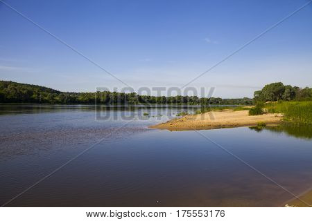 Beautiful Landscape With A River And A Sandy Beach On A Summer Day.