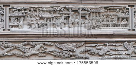 JIAXING - FEBRUARY 20: Richly carved stone bas-relief plaque on the doorway of the house in the Grand Canal, ancient town of Yuehe in Jiaxing, Zhejiang Province, China, February 20, 2016.