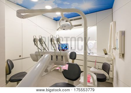 Dental clinic cabinet with dental chair in a dental clinic