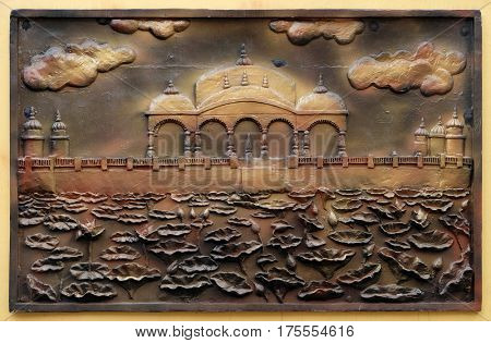 KOLKATA,INDIA - FEBRUARY 09,2016: Jalmandir-Pavapuri Bihar - the place where Lord attains Nirvan, bass relief on the wall of Jain Temple (also called Parshwanath Temple) in Kolkata, West Bengal,India