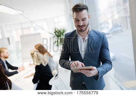 Handsome businessman ceo working in company office