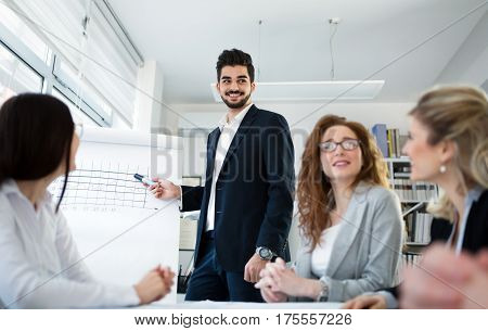 Colleagues attending seminars and business meetings in company office