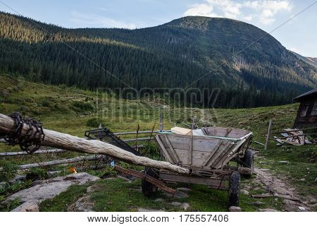 Wooden cart against the summer landscape in the Ukrainian Carpathians.