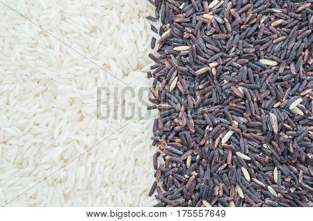 Closeup pile of mix rice by jasmine rice and riceberry rice textured background