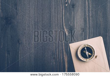 Old Compass On A Dark Wooden Background