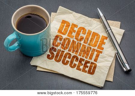Decide, commit, succeed motivational word abstract on a napkin with cup of coffee against gray slate stone background