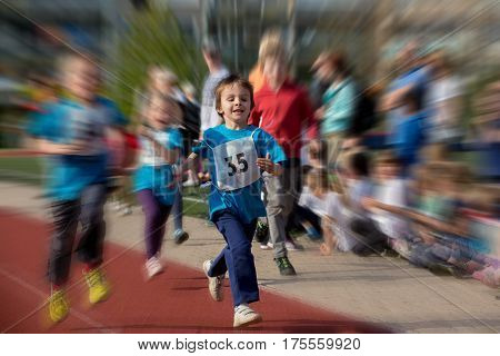 Preschool Children Run On The Marathon Road